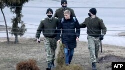 Police detain a man in Minsk on March 25.