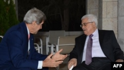 U.S. Secretary of State John Kerry (left) meets with Palestinian leader Mahmud Abbas at a hotel in Amman on July 16.