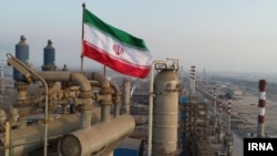 Iran's main oil export terminal is located at Kharg inside the narrow strait, which is patrolled by U.S. warships.