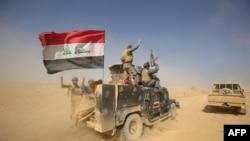 Forcat irakiane duke hyrë në fshatin Bajvanijah, 30 kilometra në jug të Mosulit, më 18 tetor të këtij viti