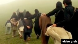 A screenshot from a purported IS video, showing Afghan prisoners being led to their deaths.