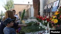 Armenia - Flowers are laid at a memorial in Yerevan to police officers killed during a July 2016 standoff with opposition gunmen, 17Jul2017.