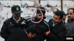 PHOTO GALLERY: In a dramatic scene at a scheduled public execution, an Iranian woman spared the life of her son's killer as he stood with a noose around his neck. The victim's relatives were tasked with pushing the chair out from under the convicted killer, but instead the victim's mother slapped him and then forgave him. The scene was captured in photographs by Arash Khamooshi of Iran's semiofficial ISNA news agency.