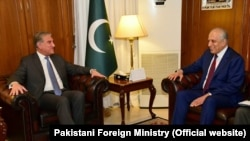 U.S. special envoy Zalmay Khalilzad (R) meets with Pakistani Foreign Minister Shah Mahmud Qureshi, in Islamabad on January 18.
