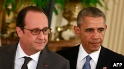 U.S. President Barack Obama (right) and French President Francois Hollande arrive for a joint news conference after their meeting at the White House on November 24.