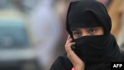 A woman talks on her mobile phone in Rawalpindi. (file photo)