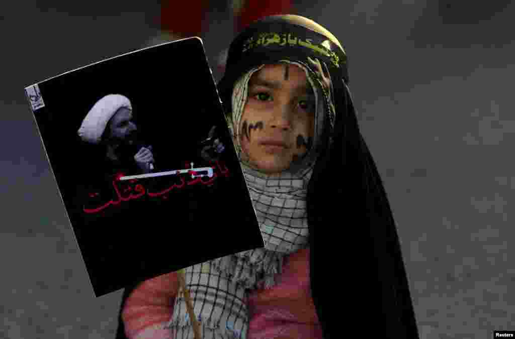 A Shi'ite Muslim girl holds a picture of Shi'ite Muslim cleric Nimr al-Nimr, who was executed in Saudi Arabia, as she takes part in a protest rally in Islamabad, Pakistan. (Reuters/Faisal Mahmood)