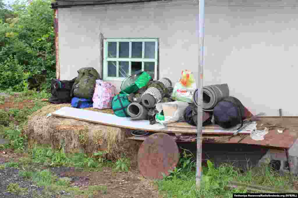 Backpacks and other things prepared at the battalion headquarters to be taken to the front