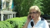 Journalist Rozlana Taukina near the Bostandyk District Court. Almaty, May 15, 2017.