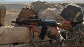 Nagorno-Karabakh -- An Armenian soldier of the self-proclaimed republic of Nagorno-Karabagh aims his assault rifle at the frontline on the border with Azerbaijan, 25Oct2012