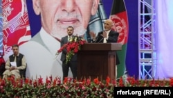Afghan President Ashraf Ghani speaks on the first day of campaigning in Kabul on July 28.