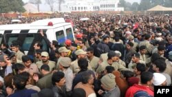Supporters and activists of the ruling Pakistan People's Party (PPP) follow the funeral procession of assassinated Punjab Governor Salman Taseer in Lahore on January 5.