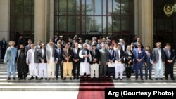 FILE: Afghan President Ashraf Ghani with the newly elected members of Wolesi Jirga on May 15.