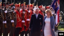 Britain's Prince Charles (left) and Croatian President Kolinda Grabar-Kitarovic inspect a guard of honor during the welcome ceremony for the Prince of Wales in Zagreb on March 14.