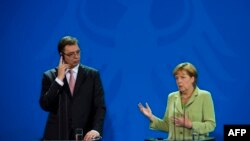 Aleksandar Vučić i Angela Merkel u Berlinu, juni 2014.