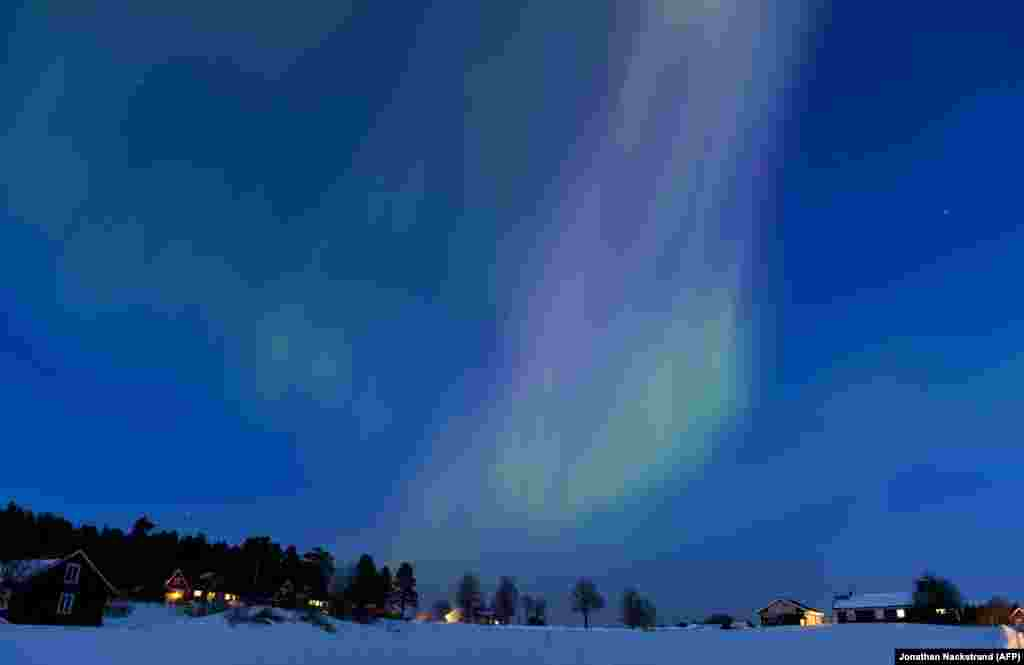 The Aurora Borealis, or northern lights, illuminate the sky over the Swedish towns of Are and Ostersund on March 17.