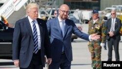 Дональд Трамп жана Бельгиянын премьер-министри Шарль Мишел Брюсселдин аэропортунда. 24-май, 2017-жыл.