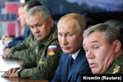 Russian President Vladimir Putin (center) is accompanied by Defense Minister Sergei Shoigu (left) and General Valery Gerasimov, the chief of staff of the Russian Armed Forces, during military exercises in September 2020.