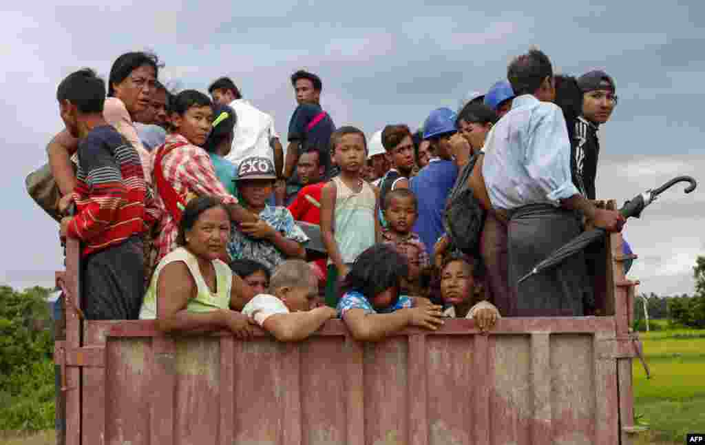 Rakhine people flee from the conflict area in Burma's Rakhine State.