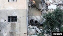 Ізраїльські військові виносять тіло вбитого бойовика, Суріф, 27 липня 2016 року