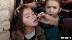 Вакцинация, обязательная или добровольная, проводится во многих странах. На снимке – вакцинация в Кветте, Пакистан, январь 2017
