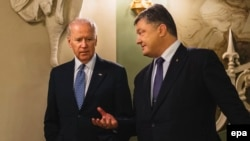 Ukrainian President Petro Poroshenko (right) with U.S. Vice President Joe Biden in Kyiv late last year.