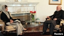 Afghan President Hamid Karzai meets with Pakistani Foreign Minister Hina Rabbani Khar in Kabul on February 1.