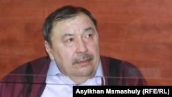 Ержан Утембаев, бывший руководитель аппарата сената парламента, осужденный по делу об убийстве Алтынбека Сарсенбаева. Каскелен, 22 января 2014 года.