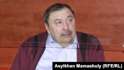 Ержан Өтембаев сот залында. Қаскелең, Алматы облысы, 22 қаңтар 2014 жыл.