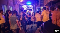 First-aid officers carry an injured man to a hospital in Gaziantep following a late-night militant attack on a wedding party in southeastern Turkey.