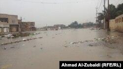 احد شوارع بغداد بعد المطر. من الارشيف