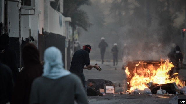 Shi'ite Bahraini protesters clash with security forces following a rally to mark the second anniversary of an uprising in the Sunni-ruled kingdom on February 14.