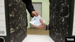 The new system, called the International Program for Monitoring Corruption (MONKOR), is currently being tested in Russia and Kyrgyzstan. (file photo)