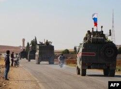 کاروان نیروهای روسیه در راه کوبانی