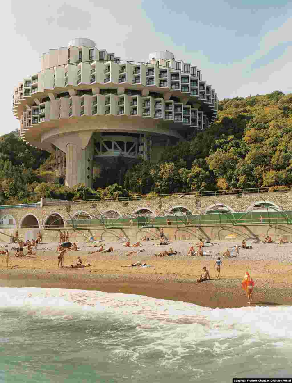 "The Druzhba sanatorium in Yalta, Ukraine, designed by Igor Vasilevsky and Yuriy Stefanchuk and dating from 1985. ""What is fascinating is to realize that basically the trends -- the intellectual main trends -- that were going through East and West were the same,"" Chaubin said. ""East and West at the same time were worshipping the future. This is the very end of modernism in some way. ""Right now, we're totally frightened by the future. But at that time, there was still a very optimistic perspective. And you can feel it with the architecture. There was this idea that the future would bring something better."""