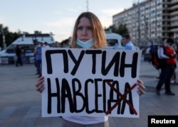 A woman takes part in a protest against the amendments in central Moscow on July 1.