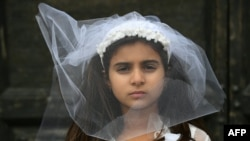 ITALY -- A young actress plays the role of Giorgia, 10, forced to marry Paolo, 47, during an event organized by Amnesty International to denounce child marriage, on October 27, 2016 in Rome.