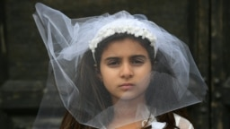 A young actress plays the role of Giorgia, 10, forced to marry Paolo, 47, during an event organized by Amnesty International to denounce child marriage, on October 27, 2016 in Rome. File photo