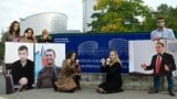 Azerbaijani rights activists protest in front of Council of Europe in 2013.