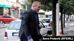 Key witness Aleksandar Sindjelic arrives at the Podgorica court.