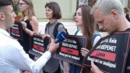 "Many were holding posters saying, ""Pavel Sheremet. 20.07.2016. Murderers still not found."""