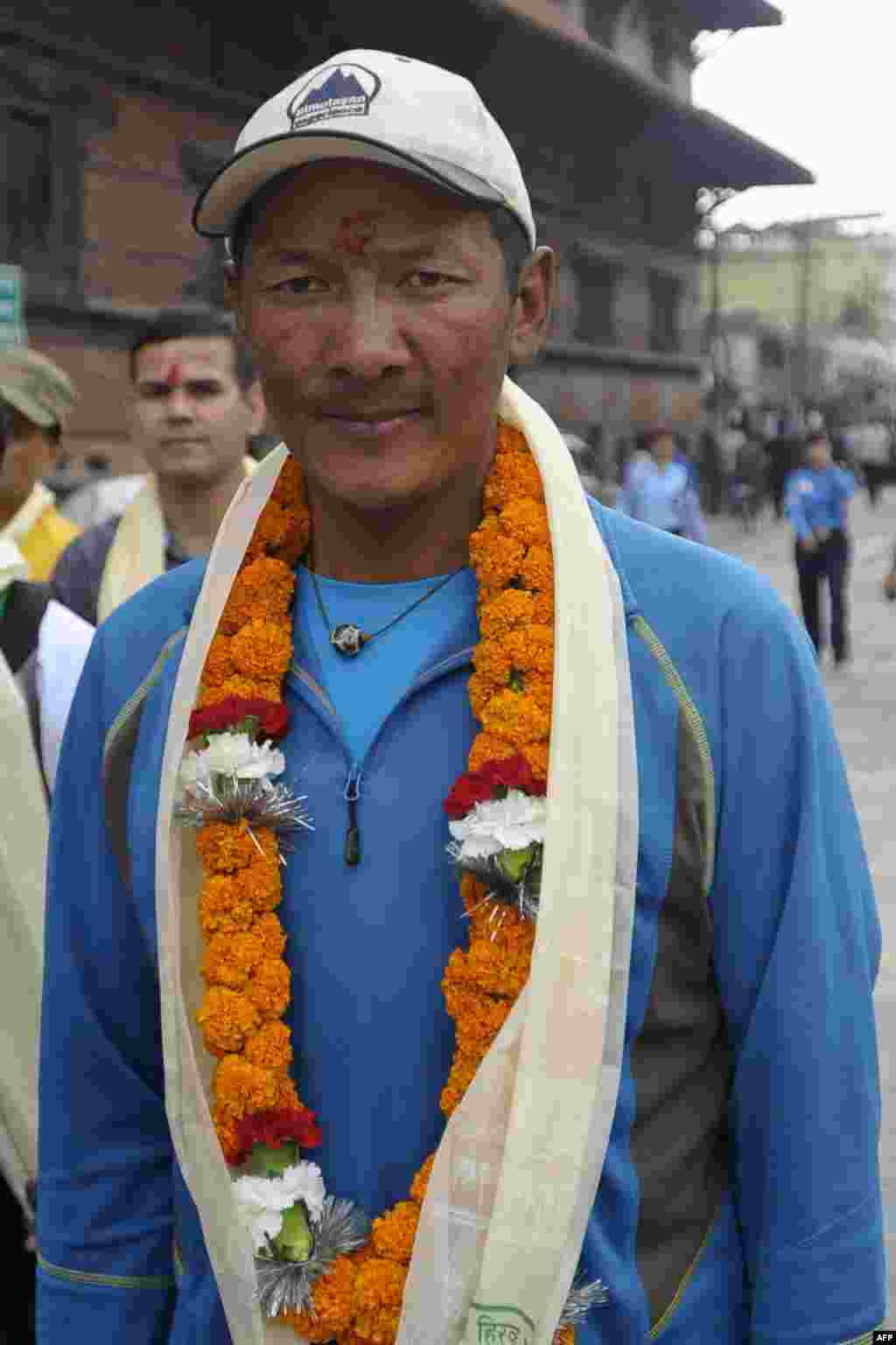 Nepalese mountaineer Phurba Tashi Sherpa, who has summitted Everest a record 21 times, takes part in the Diamond Jubilee celebrations.