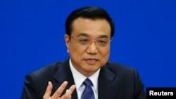 Қытай премьер-министрі Ли Кэцян Бүкілқытайлық халық депутаттарының сессиясының жабылуында сөйлеп тұр. Пекин, 13 наурыз 2014 жыл.