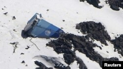 The wreckage of a Pamir Airways plane lies on a mountain north Kabul.