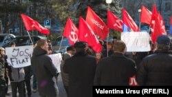 Opoziţia comunistă a cerut demisia guvernului