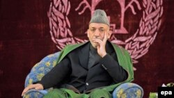 Afghan President Hamid Karzai at a meeting with elders in Konduz (file photo)