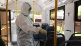 KYRGYZSTAN -- Bishkek - COVID-19 - coronavirus - worker in protective uniform disinfects buses in Bishkek - Bishkek city administration intensifies disinfection in public transport June 21, 2021
