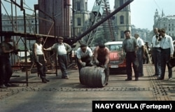 A barrel of wine is rolled over the Elisabeth Bridge in Budapest upon its structural completion in 1964.