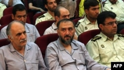 Former Vice President Mohammad Ali Abtahi (center) is among the defendants on trial.