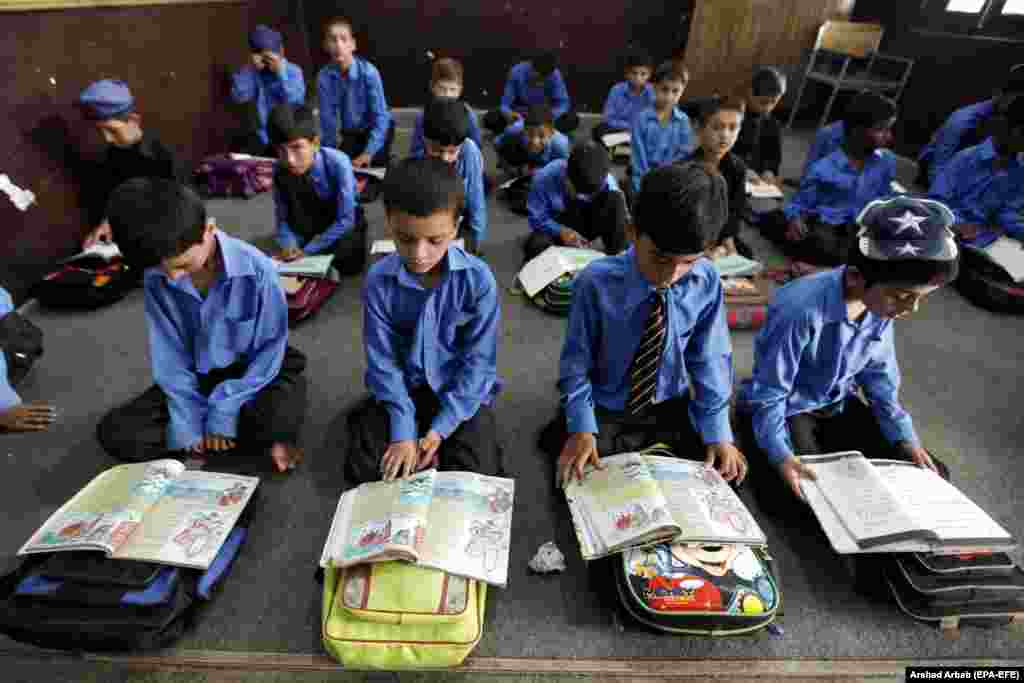 Pakistani boys attend school a day ahead of International Literacy Day in Peshawar. International Literacy Day is observed on September 8 each year. This year's theme is Literacy And Health. (epa/Arshad Arbab)